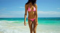 Carefree Latin American girl in pink bikini at luxury beach resort - stock footage
