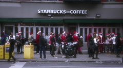 Santa Claus Costume Crowd during Christmas at Starbucks in New York City - stock footage