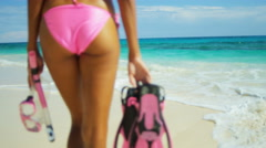 Beautiful young brunette girl in bikini snorkeling on tropical beach - stock footage