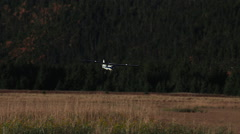 Alaska Bush Plane Coming in for a Landing on Remote Air Strip Stock Footage