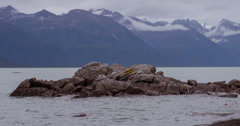 Alaska Coast line and Rocky Outcrop Pull Back Slow 4K Stock Footage