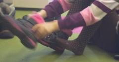 Girl Dresses the Boots Decorated With Pink Fur. Stock Footage