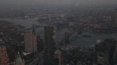 Snow Falling Over New York City with Brooklyn Bridge and East River Aerial Stock Footage