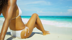 Young ethnic girl sunbathing on a on a tropical beach - stock footage