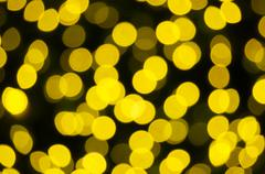 Defocused of glitter or yellow bokeh - stock photo