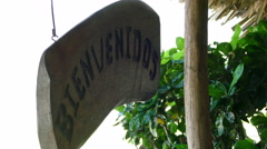 Wooden sign with Bienvenidos Stock Footage