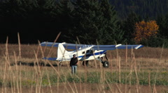 Bush Pilot Walking Away From Plane in Remote Setting Stock Footage