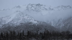Cold and Snowy Mountain Pan Right Stock Footage