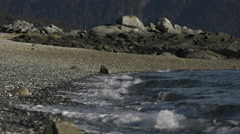 Curling Sea Waves Slow Motion Upon Rocky Beach Line Stock Footage
