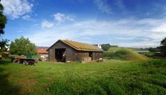 Germany Bavaria Harvested Hops waste rest covered Solar panels on roof - stock photo