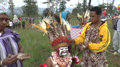 Stock Video Footage of Aboriginal woman placing feather on young woman head before ritual dance