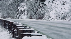 Modern Pickup on Icy Winter Road With Guard Rail - stock footage