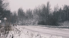 Modern Red Pickup Passing Camera on Icy Winter Highway Stock Footage