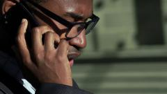 black corporate employer working outdoor with smartphone: overworked man - stock footage