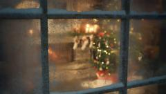 Christmas tree scene through frozen window Stock Footage