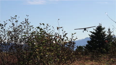 Small Airplane Landing in Field. Stock Footage