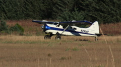 Small Bush Plane Taxie On Field Stock Footage