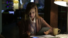 Young woman use tablet, internet shopping - stock footage