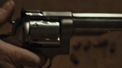 Stock Video Footage of Stainless Steel Handgun Cocking