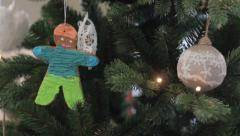 Gingerbread  hanging under fir branch Stock Footage