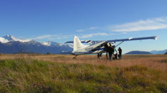 Unloading Bush Plane In Alaska Stock Footage