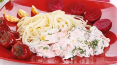Mediterranean cuisine: rose salmon baked in cream cheese sauce Stock Footage