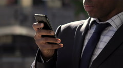 business suit: elegant businessman using smartphone: texting, typing messages - stock footage