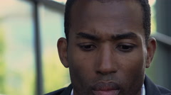 Worried and discomforted black businessman portrait: american african 30s Stock Footage