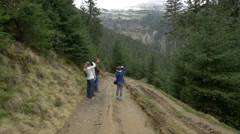 Tourists taking pictures of Horses Waterfall Stock Footage