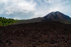Cold lava residual in front of not active volcano near Antigua Stock Photos