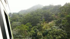 Rainforest at hilly landscape, view from moving gondola lift Stock Footage