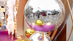Close view disco ball spin, outdoor installation, glitter reflection Stock Footage