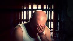 Prisoner Sitting Near Cell Window - stock footage