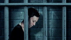 Sad woman in a jail cell 2 Stock Footage