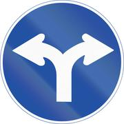 South Korean mandatory direction sign - Turn left or right - stock illustration