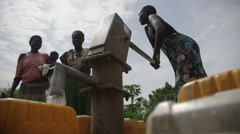 South Sudan Gorom refugee camp water pump Stock Footage