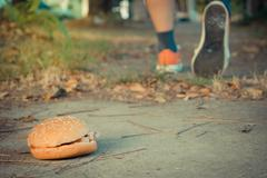 Hamburger and jogging , process in vintage style - stock photo