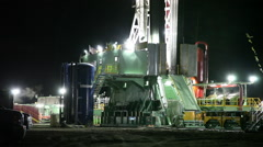 Oil and Gas Fracking Site at Night Stock Footage