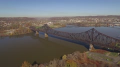 Aerial Shot Following Train Go Over Railroad Bridge in Monaca, PA Stock Footage