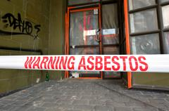 Sign reads: Warning - Asbestos removal in progress Stock Photos