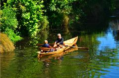 Couple Rowing row boat over Avon River Christchurch - New Zealand Stock Photos