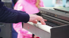 Stock Video Footage of Pianist in the mask plays the piano on the street in the winter