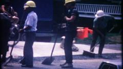 2983 - road construction workers repair city street - vintage film home movie - stock footage