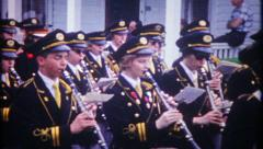 2980 - high school marching band in local parade - vintage film home movie - stock footage