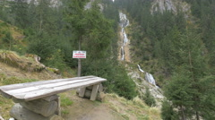 Wooden bench and a keep area clean sign near the Horses Waterfall Stock Footage