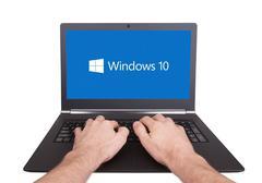 Stock Photo of HEERENVEEN, NETHERLANDS, June 6, 2015: Laptop computer with Windows 10 logo.