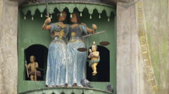 Group of wooden figurines arranged in niches at the Clock Tower, Sighisoara Stock Footage