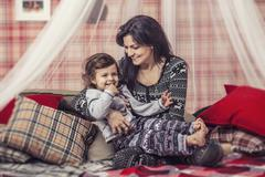 Happy family mother and baby together at home in the cosy atmosphere Stock Photos
