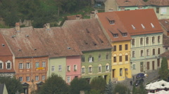 Beautiful old buildings on a street in Sighisoara Stock Footage