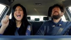 Man and woman slow motion dancing in car happy Stock Footage